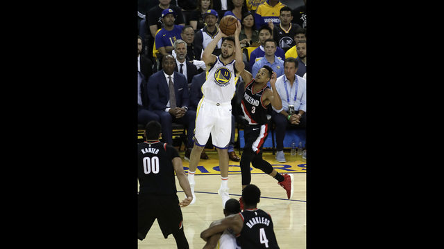 a32412956d47 Golden State Warriors  Klay Thompson (11) shoots past Portland Trail  Blazers  CJ McCollum (3) during the first quarter of Game 1 of the NBA  basketball ...