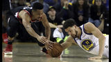 Portland Trail Blazers' CJ McCollum, left, and Golden State Warriors' Klay Thompson reach for the ball during the first half of Game 1 of the NBA basketball playoffs Western Conference finals Tuesday, May 14, 2019, in Oakland, Calif. (AP Photo/Ben Margot)
