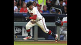 Atlanta Braves Ronald Acuna Jr. steals third base and loses his helmet going home to score on the errant throw during the third inning of a baseball game against the St. Louis Cardinals, Wednesday, May 15, 2019, in Atlanta. (Curtis Compton/Atlanta Journal-Constitution via AP)