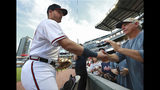Atlanta Braves outfielder Austin Riley gets encouragement from his dad Mike Riley as he takes the field to make his major league debut against the St. Louis Cardinals prior to a baseball game, Wednesday, May 15, 2019, in Atlanta. (Curtis Compton/Atlanta Journal-Constitution via AP)
