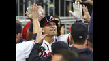 Atlanta Braves outfielder Austin Riley gets high fives in the dugout hitting a solo home run during the fourth inning of a baseball game against the St. Louis Cardinals, Wednesday, May 15, 2019, in Atlanta. (Curtis Compton/Atlanta Journal-Constitution via AP)