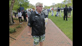 John Daly walks around the putting green before playing a practice round for the PGA Championship golf tournament, Wednesday, May 15, 2019, at Bethpage Black in Farmingdale, N.Y. (AP Photo/Seth Wenig)