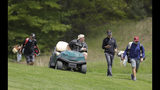 John Daly, second from left, talks with Kelly Kraft, second from right, as they move to the ninth fairway during a practice round for the PGA Championship golf tournament, Wednesday, May 15, 2019, at Bethpage Black in Farmingdale, N.Y. (AP Photo/Julio Cortez)