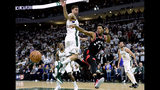Toronto Raptors guard Kyle Lowry (7) passes the ball under pressure from Milwaukee Bucks forward Nikola Mirotic (41) during the second half in Game 1 of the NBA basketball playoffs Eastern Conference final in Milwaukee on Wednesday, May 15, 2019. (Frank Gunn/The Canadian Press via AP)