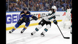 St. Louis Blues left wing Sammy Blais (9) tries to slow down San Jose Sharks defenseman Erik Karlsson (65), of Sweden, during the third period in Game 3 of the NHL hockey Stanley Cup Western Conference final series Wednesday, May 15, 2019, in St. Louis. (AP Photo/Jeff Roberson)