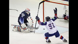 Great Britain's Ben Lake, right, celebrates his sides second goal scored past goaltender Thatcher Demko of the US, left, during the Ice Hockey World Championships group A match between the United States and Great Britain at the Steel Arena in Kosice, Slovakia, Wednesday, May 15, 2019. (AP Photo/Petr David Josek)
