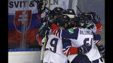 Great Britain's Brett Perlini, right, celebrates with teammates after scoring his sides second goal during the Ice Hockey World Championships group A match between the United States and Great Britain at the Steel Arena in Kosice, Slovakia, Wednesday, May 15, 2019. (AP Photo/Petr David Josek)