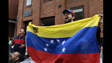 Protester Andres Miguel Harris, who was born in Venezuela, protests with other outside the Venezuelan embassy in Washington, Tuesday, May 14, 2019. (AP Photo/Susan Walsh)