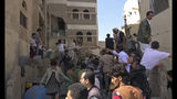 In this frame grab from from video, people search in the rubble following Saudi-led coalition airstrikes that killed at least six, including children, officials said, in the residential center of the capital, Sanaa, Yemen, Thursday, May 16, 2019. The Sanaa airstrikes came after Yemen's Iran-backed Houthi rebels, who control the capital, launched a drone attack earlier in the week on a critical oil pipeline in Saudi Arabia, Tehran's biggest rival in the region. (AP Photo)