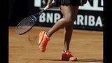 Japan's Naomi Osaka removes the court soil away from her shoe during her match against Slovakia's Dominika Cibulkova at the Italian Open tennis tournament, in Rome, Thursday, May, 16, 2019. (AP Photo/Gregorio Borgia)