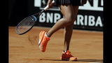 Japan's Naomi Osaka removes the court soil away from her shoe during her match against Slovakia's Dominika Cibulkova at the Italian Open tennis tournament, in Rome, Thursday, May, 16, 2019. (AP Photo/Gregorio Borgia)