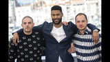 Actors Damien Bonnard, from left, Djebril Zonga and Alexis Manenti pose for photographers at the photo call for the film 'Les Miserables' at the 72nd international film festival, Cannes, southern France, Thursday, May 16, 2019. (Photo by Vianney Le Caer/Invision/AP)