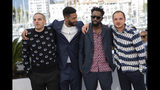 Actors Damien Bonnard, from left, Djebril Zonga, director Ladj Ly and actor Alexis Manenti pose for photographers at the photo call for the film 'Les Miserables' at the 72nd international film festival, Cannes, southern France, Thursday, May 16, 2019. (Photo by Vianney Le Caer/Invision/AP)