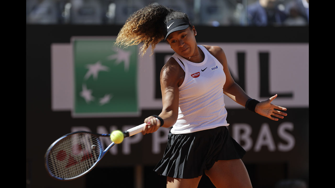 Osaka wins first of 2 matches in a busy day at Italian Open | FOX23