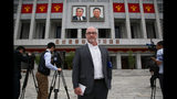 This Monday, May 9, 2016 photo shows The Associated Press' Pyongyang Bureau Chief Eric Talmadge in front of the April 25 House of Culture where the party congress is held in the North Korean capital. Talmadge, who as North Korea bureau chief for the AP tenaciously chronicled life and politics in one of the world's least-understood nations, has died. He was 57. Talmadge died in Japan after suffering a heart attack while running. (AP Photo/Wong Maye-E)