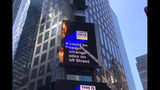In this image from video provided by WABC TV, flames shoot from the digital billboard at 3 Times Square in New York City, Saturday, May 18, 2019. The Fire Department says no injuries have been reported and there was no damage to the building the sign is attached to. (WABC TV via AP)