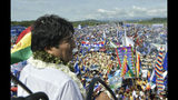 In this handout photo released by the government-run Bolivian Information Agency, Bolivia's President Evo Morales, who is running for re-election with the Movement Toward Socialism, MAS, party, speaks during the opening campaign rally on a runway at the airport in Chimore, Bolivia, Saturday, May 18, 2019. Morales is running for a fourth term. (Freddy Zarco/Bolivian Information Agency via AP)