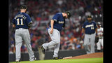 Milwaukee Brewers pitcher Matt Albers, center, reacts, before being taken out of a baseball game during the sixth inning after walking Atlanta Braves' Josh Donaldson, Saturday, May 18, 2019, in Atlanta. (AP Photo/John Amis)