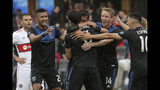 San Jose Earthquakes forward Chris Wondolowski, center back, is congratulated by teammates after scoring a goal against the Chicago Fire during the first half of an MLS soccer match in San Jose, Calif., Saturday, May 18, 2019. (AP Photo/Jeff Chiu)