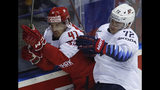 Frank Vatrano of the US, right, checks Denmark's Jesper Jensen Aabo, left, during the Ice Hockey World Championships group A match between Denmark and the United States at the Steel Arena in Kosice, Slovakia, Saturday, May 18, 2019. (AP Photo/Petr David Josek)