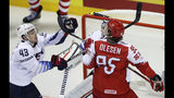 Denmark's Nick Olesen, right, challenges Quinn Hughes of the US, left, during the Ice Hockey World Championships group A match between Denmark and the United States at the Steel Arena in Kosice, Slovakia, Saturday, May 18, 2019. (AP Photo/Petr David Josek)