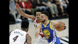 Golden State Warriors guard Stephen Curry (30) drives past Portland Trail Blazers guard CJ McCollum, center, during the first half of Game 3 of the NBA basketball playoffs Western Conference finals, Saturday, May 18, 2019, in Portland, Ore. (AP Photo/Ted S. Warren)