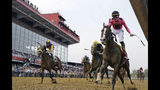 Jockey Tyler Gaffalione, right, reacts aboard War of Will, as they crosses the finish line first to win the Preakness Stakes horse race at Pimlico Race Course, Saturday, May 18, 2019, in Baltimore.(AP Photo/Steve Helber)
