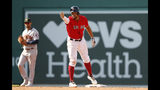 Boston Red Sox's Xander Bogaerts signals towards his dugout after his RBI double against the Houston Astros during the seventh inning of a baseball game Sunday, May 19, 2019, at Fenway Park in Boston. (AP Photo/Winslow Townson)