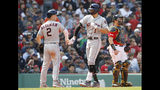 Houston Astros' Carlos Correa is greeted by Alex Bregman (2) after his two-run home run as Boston Red Sox catcher Christian Vazquez looks on during the third inning of a baseball game against the Boston Red Sox, Sunday, May 19, 2019, at Fenway Park in Boston. (AP Photo/Winslow Townson)