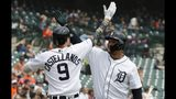 Detroit Tigers' Nicholas Castellanos (9) exchanges a high five with Miguel Cabrera after hitting a solo home run during the third inning of a baseball game against the Oakland Athletics, Sunday, May 19, 2019, in Detroit. (AP Photo/Carlos Osorio)