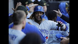 Toronto Blue Jays' Vladimir Guerrero Jr., celebrates with teammates after hitting a two-run home run during the eighth inning of a baseball game against the Chicago White Sox in Chicago, Sunday, May 19, 2019. (AP Photo/Nam Y. Huh)