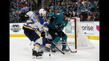 San Jose Sharks' Logan Couture (39) battles for the puck against St. Louis Blues' Alex Pietrangelo (27) in the first period in Game 5 of the NHL hockey Stanley Cup Western Conference finals in San Jose, Calif., on Sunday, May 19, 2019. (AP Photo/Josie Lepe)