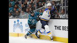 San Jose Sharks' Kevin Labanc (62) battles against the boards with St. Louis Blues' Colton Parayko (55) in the first period in Game 5 of the NHL hockey Stanley Cup Western Conference finals in San Jose, Calif., on Sunday, May 19, 2019. (AP Photo/Josie Lepe)