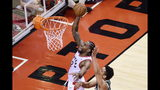 Toronto Raptors forward Kawhi Leonard (2) scores past Milwaukee Bucks guard Malcolm Brogdon (13) during the second overtime period of Game 3 of the NBA basketball playoffs Eastern Conference finals in Toronto on Sunday, May 19, 2019. (Frank Gunn/The Canadian Press via AP)