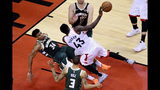 Milwaukee Bucks forward Giannis Antetokounmpo (34) fouls out of the game as Toronto Raptors forward Pascal Siakam (43) drives to the net during the second overtime period of Game 3 of the NBA basketball playoffs Eastern Conference finals in Toronto on Sunday, May 19, 2019. (Frank Gunn/The Canadian Press via AP)