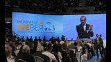 Germany's Manfred Weber of the European People's Party, on the monitor, applauds after addressing the audience at the Bulgaria's GERB ruling Party rally in Sofia, Bulgaria, Sunday, May 19, 2019. The rally comes days before more than 400 million Europeans from 28 countries will head to the polls to choose lawmakers to represent them at the European Parliament for the next five years. (AP Photo/Valentina Petrova)