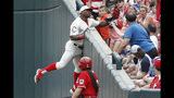 Cincinnati Reds' Yasiel Puig catches a foul ball hit by Los Angeles Dodgers' Hyun-Jin Ryu in the sixth inning of a baseball game, Sunday, May 19, 2019, in Cincinnati. (AP Photo/John Minchillo)