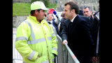 France's President Emmanuel Macron talks to a worker during a visit to Biarritz, southwestern France, Friday, May 17, 2019. (AP Photo/Bob Edme)