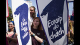 People hold posters reading: 'Elect a Europe for all' as they attend a demonstration in Berlin, Germany, Sunday, May 19, 2019. People across Europe attend demonstrations under the slogan 'A Europe for All - Your Voice Against Nationalism'. (AP Photo/Markus Schreiber)
