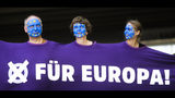 """People, with faces painted like a European flag, arrive for a demonstration in Berlin, Germany, Sunday, May 19, 2019. People across Europe attend demonstrations under the slogan 'A Europe for All - Your Voice Against Nationalism'. The banner reads 'For Europe"""". (AP Photo/Markus Schreiber)"""