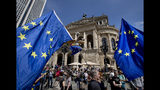 People wave European flags in front of the Old Opera during a demonstration in Frankfurt, Germany, Sunday, May 19, 2019. People across Europe attend demonstrations under the slogan 'A Europe for All - Your Voice Against Nationalism'. (AP Photo/Michael Probst)