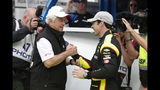 Simon Pagenaud, of France, is congratulated by car owner Roger Penske after winning the pole during qualifications for the Indianapolis 500 IndyCar auto race at Indianapolis Motor Speedway, Sunday, May 19, 2019 in Indianapolis. (AP Photo/Michael Conroy)