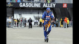Fernando Alonso, of Spain, rides his scooter back to the garage after rain ended a practice session for the Indianapolis 500 IndyCar auto race at Indianapolis Motor Speedway, Sunday, May 19, 2019 in Indianapolis. (AP Photo/Darron Cummings)