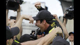 Simon Pagenaud, of France, celebrates with his crew after winning the pole for the Indianapolis 500 IndyCar auto race at Indianapolis Motor Speedway, Sunday, May 19, 2019 in Indianapolis. (AP Photo/Darron Cummings)