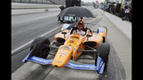 The crew of Fernando Alonso, of Spain, pulls the car back to the garage area after rain ended a practice session for the Indianapolis 500 IndyCar auto race at Indianapolis Motor Speedway, Sunday, May 19, 2019 in Indianapolis. (AP Photo/Michael Conroy)