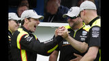 Simon Pagenaud, of France, celebrates with his crew after winning the pole during qualifications for the Indianapolis 500 IndyCar auto race at Indianapolis Motor Speedway, Sunday, May 19, 2019 in Indianapolis. (AP Photo/Michael Conroy)