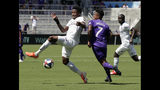 FC Cincinnati's Alvas Powell, left, tries to clear the ball away from Orlando City's Cristian Higuita (7) during the first half of an MLS soccer match, Sunday, May 19, 2019, in Orlando, Fla. (AP Photo/John Raoux)