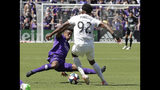 Orlando City's Cristian Higuita, left, makes a move to stop FC Cincinnati's Alvas Powell (92) from advancing the ball during the first half of an MLS soccer match, Sunday, May 19, 2019, in Orlando, Fla. (AP Photo/John Raoux)