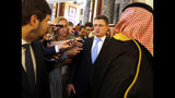 Russian Minister of Energy Alexander Novak is surrounded by reporters as he arrives to attend a meeting of the energy ministers from OPEC and its allies to discuss prices and production cuts, in Jiddah, Saudi Arabia, Sunday, May 19, 2019. The meeting takes places as tensions flare in the Persian Gulf after the U.S. ordered bombers and an aircraft carrier to the region over an unexplained threat they perceive from Iran, which comes a year after the U.S. unilaterally pulled out of Tehran's nuclear deal with world powers and reimposed sanctions on Iranian oil. (AP Photo/Amr Nabil)