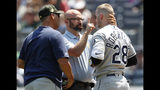 Tampa Bay Rays manager Kevin Cash, left, watches as Daniel Robertson (28) is examined by a trainer after he was hit by a pitch thrown by New York Yankees pitcher Chad Green during the second inning of a baseball game, Sunday, May 19, 2019, in New York. (AP Photo/Kathy Willens)